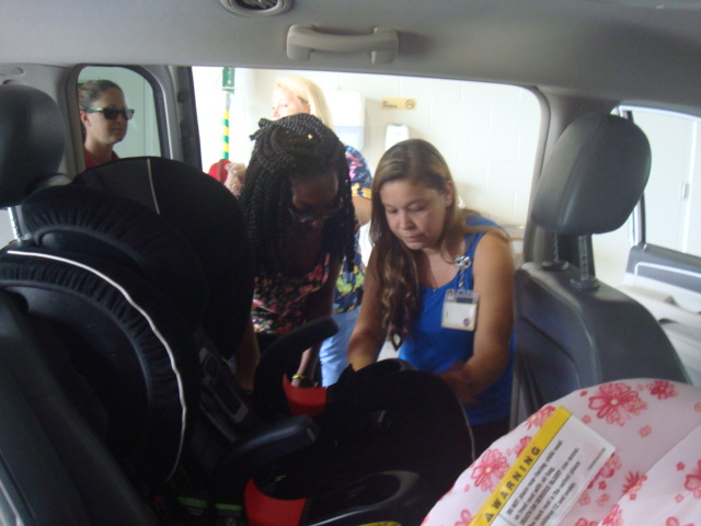 Certified Technicians show new parents how to properly install a car seat.